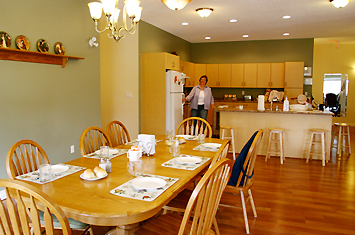 We offer a spacious kitchen with an open and friendly dining area!